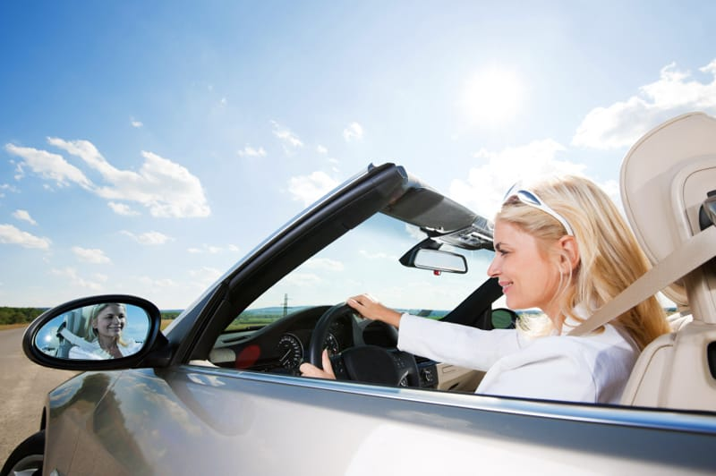 Young blonde businesswoman is enjoying in the road trip. [url=http://www.istockphoto.com/search/lightbox/9786750][img]http://dl.dropbox.com/u/40117171/summer.jpg[/img][/url]